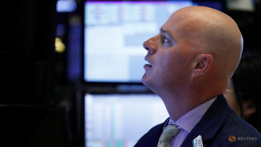 Wall Street dives into the red, losses sparked by Apple fears