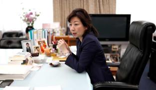 Japan's Noda, former gender equality minister, joins PM race