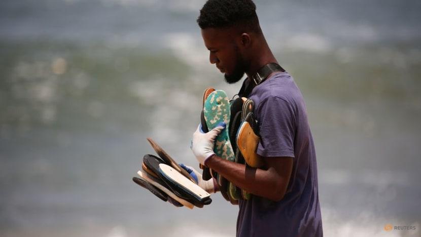 Ivorian artist turns discarded flip-flops from beach into masterpieces