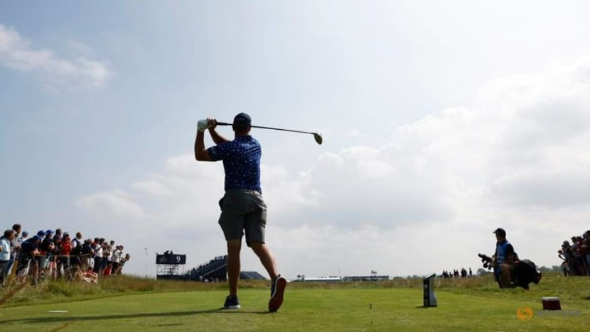 Golf-Defending champion Lowry grouped with Rahm in Open first round