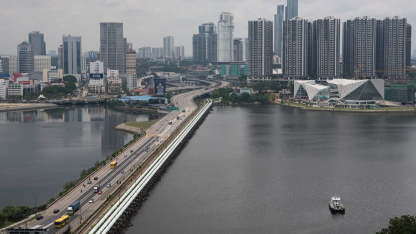 Malaysia will continue negotiating with Singapore on border reopening: Foreign Minister Saifuddin