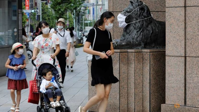 Tokyo lowers alert level as COVID-19 fears ease