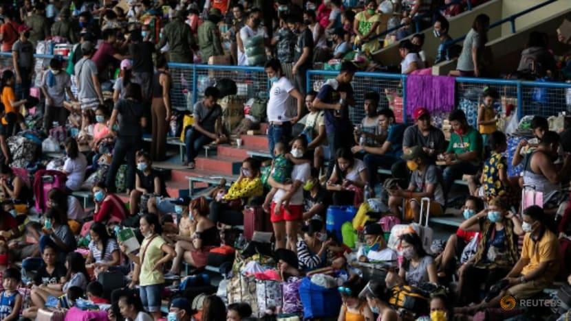 Thousands of stranded Filipinos crammed into baseball stadium amid COVID-19 risks
