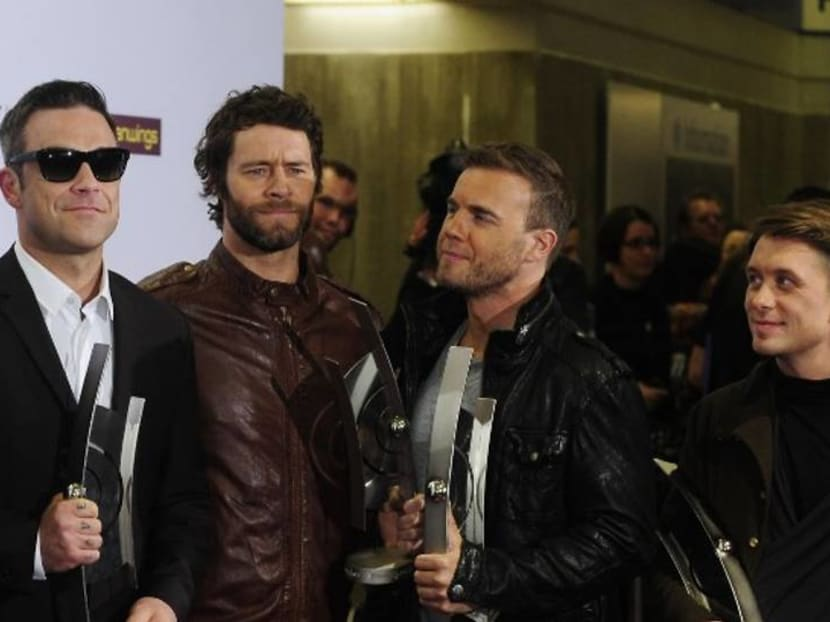 Back for now: Robbie Williams reunites with Take That for charity concert