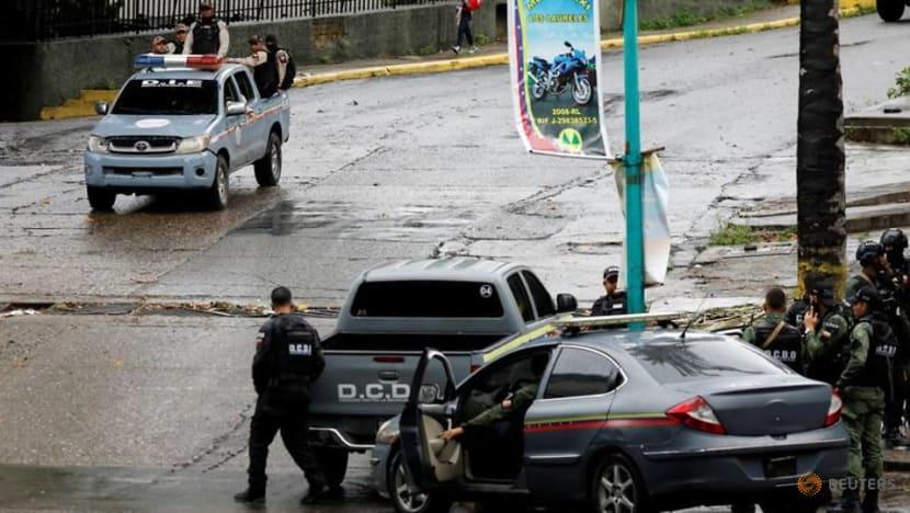 Clashes between police, Caracas gang leave 26 dead, Venezuela says
