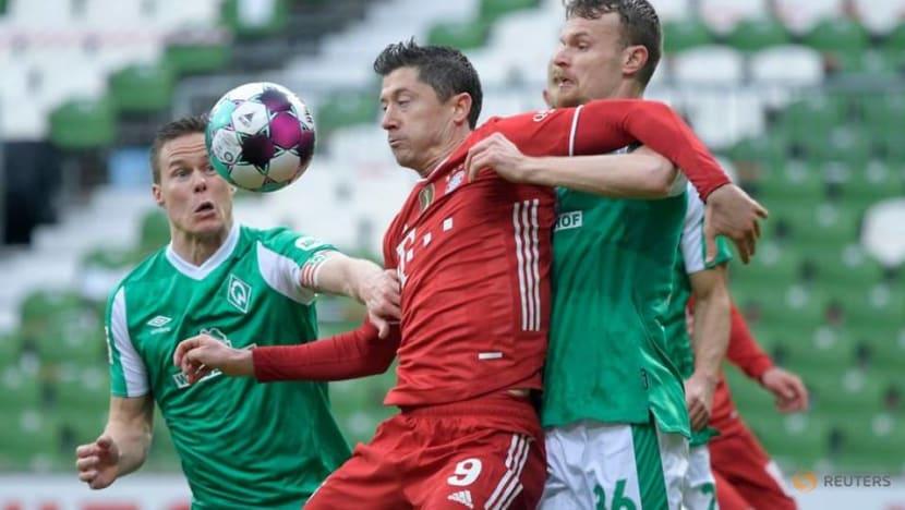 Football: Lewandowski landmark goal helps Bayern to 3-1 win at Werder