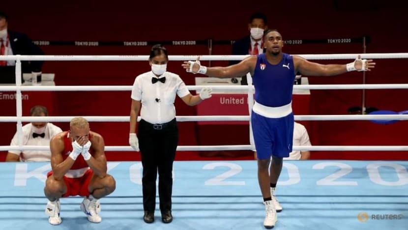 Olympics-Boxing-Cuba's Lopez wins men's light-heavyweight gold