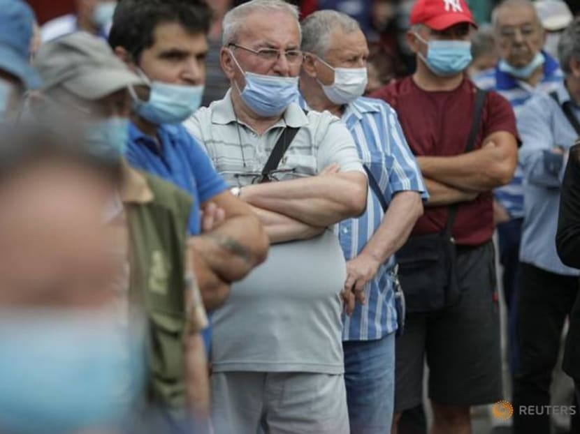 Romanians queue for COVID-19 vaccine and free barbecue at bustling market