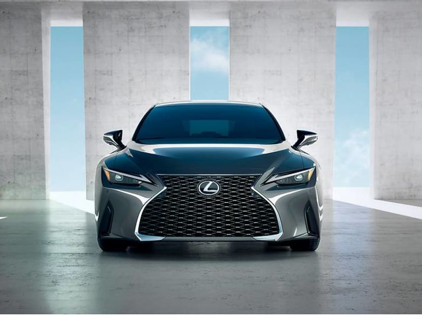 Why is the new Lexus IS still equipped with a built-in CD and DVD player?