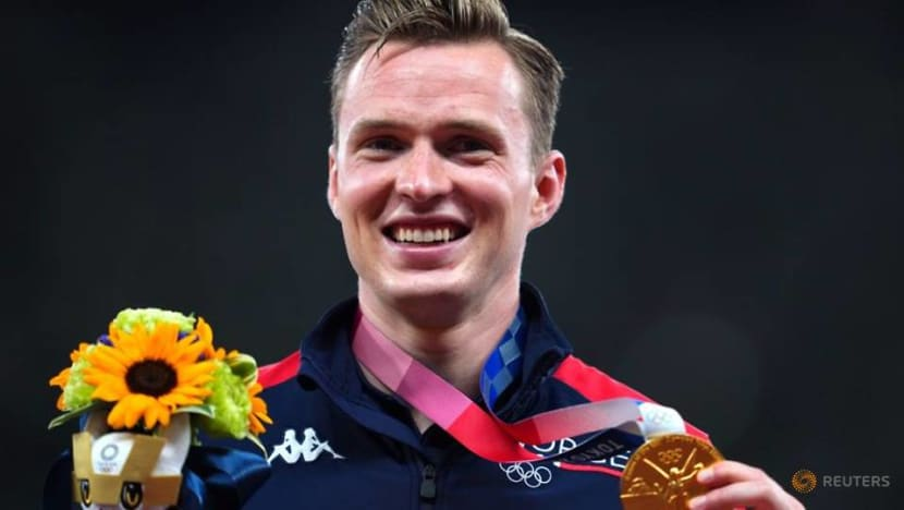 Olympics-Athletics-Records tumble on amazing day