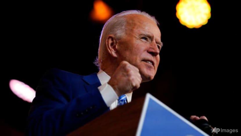 Biden vows no quick rollback of Trump's China tariffs