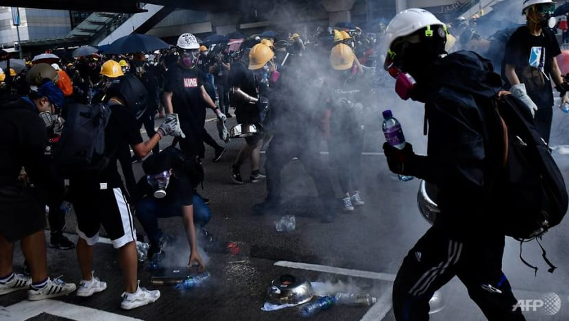Hong Kong police fire tear gas, rubber bullets as strikes paralyse city