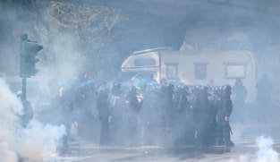 Italian police use water cannon to break up health pass protest at port