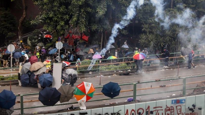 Choking and crying, Hong Kong protesters pinned back on campus