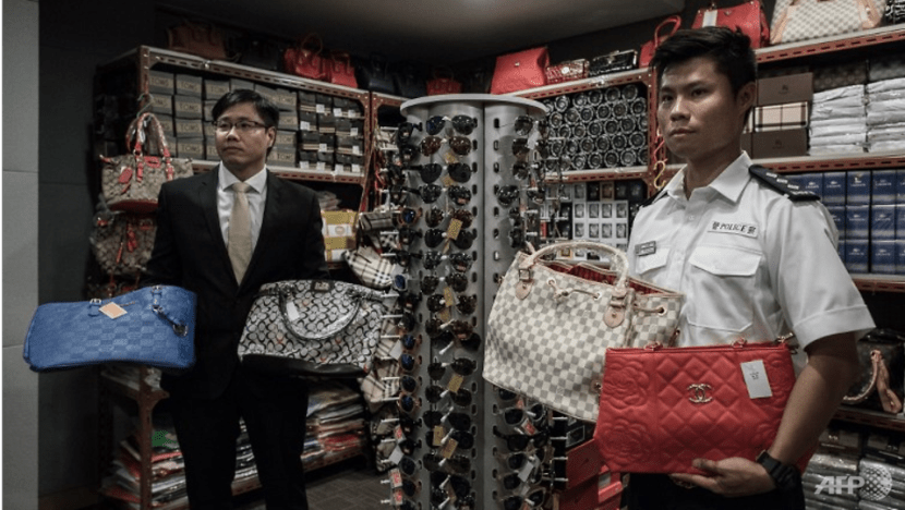 Commentary: Who on earth still buys counterfeit branded goods?