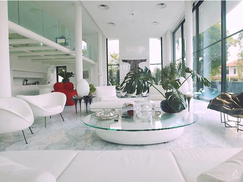 A 9,300 sq ft home in Singapore with glass floors and plenty of curves