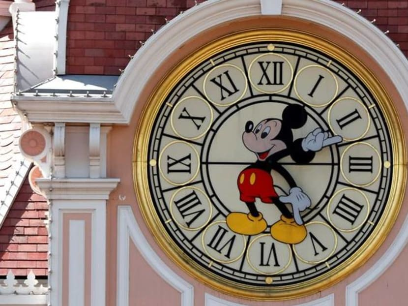 Masks and Mickey: Disneyland Paris reopens after four-month closure