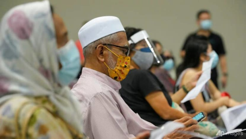 Commentary: What's behind no-shows in vaccination centres across Malaysia?