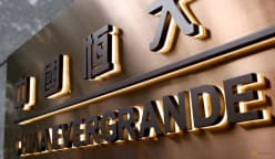 China Evergrande wires funds for bond coupon, averting default