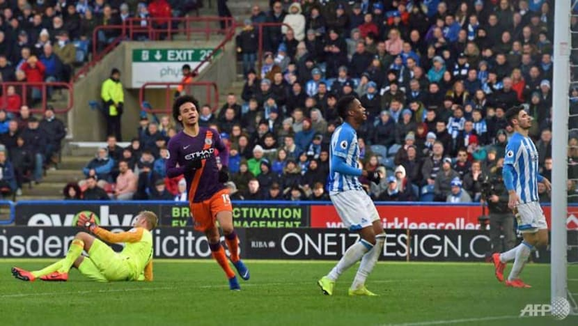 Football: Man City ease past Huddersfield to cut Liverpool's lead