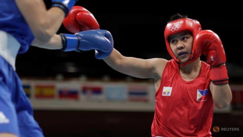 Olympics-Boxing-Filipina Petecio advances to finals; old rivals to meet in semis
