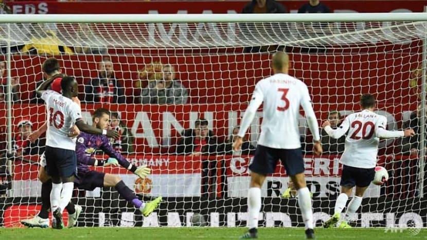 Football: Man United end Liverpool's winning run in 1-1 draw