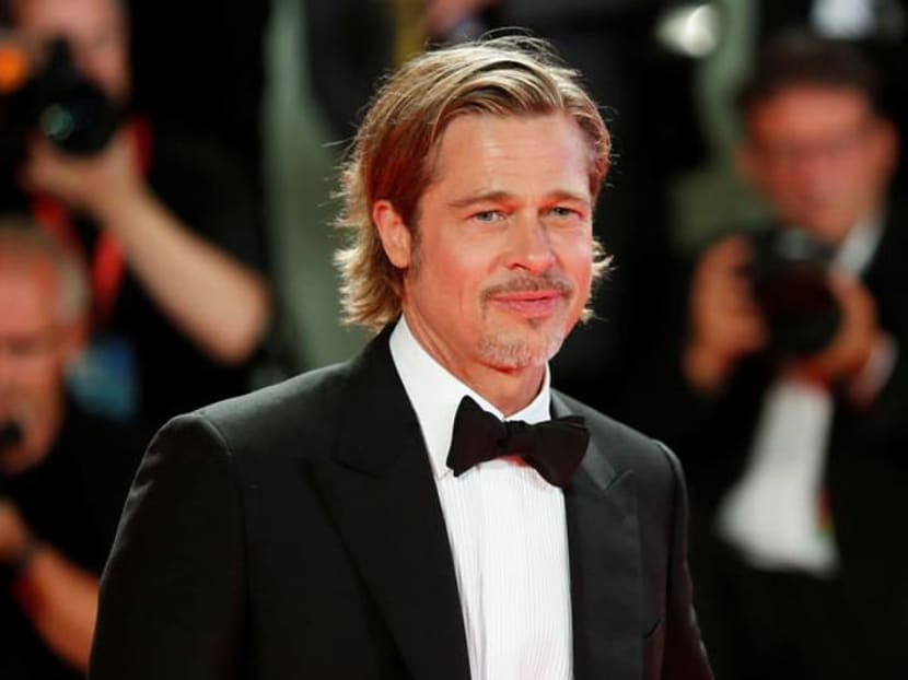 Brad Pitt calls an astronaut in space to ask if he's better than George Clooney