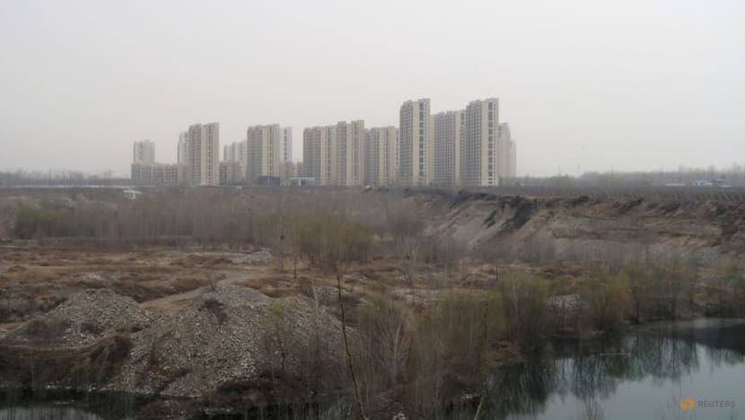 China's new home price growth slows amid tightened rules