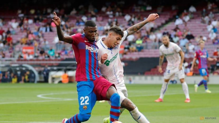Football: Depay on target in narrow Barca win over Getafe