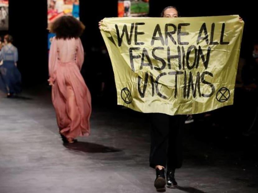 Environmental protester crashes Dior runway show at Paris Fashion Week