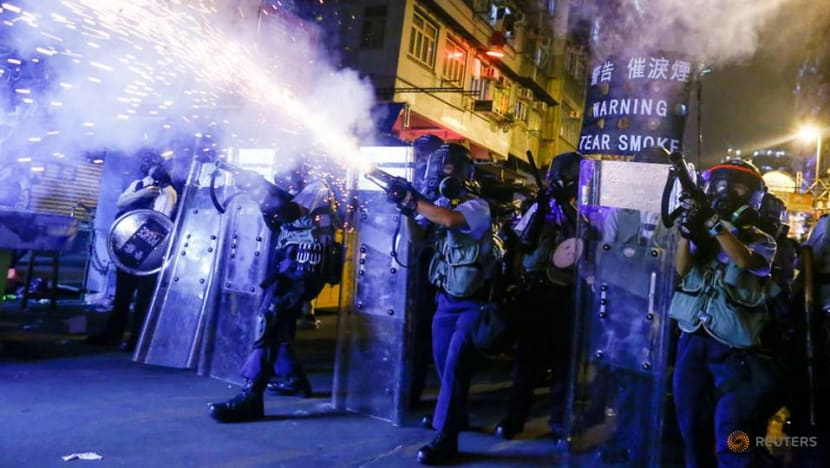 Hong Kong protests: 180 police officers injured, families 'bullied and intimidated'