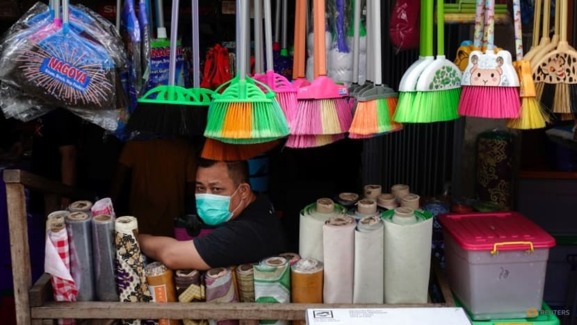 Indonesia extends COVID-19 curbs as infections spread in regions