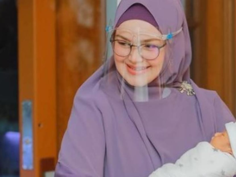 Malaysian singer Siti Nurhaliza and husband fined RM20,000 for baby's ceremony which breached COVID-19 protocols