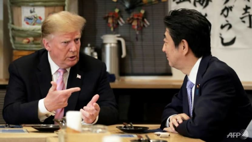 Japan PM Abe says determined to show world strong alliance with US