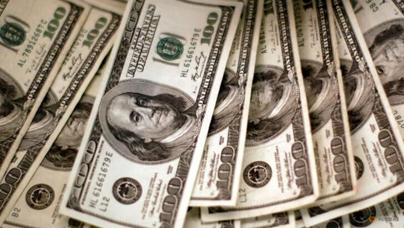 Dollar retreats from 9-month high as stock rally lifts sentiment