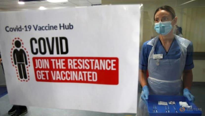 In COVID-19 milestone for West, Britain starts mass vaccination