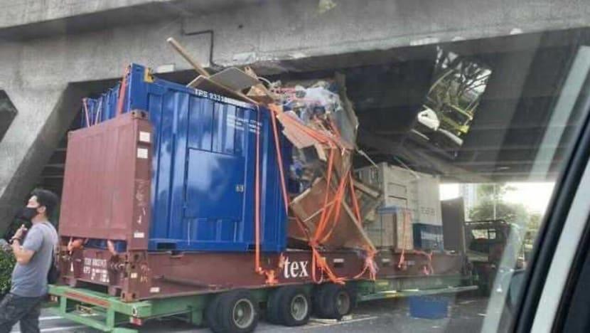 Driver arrested after trailer collides into flyover along AYE