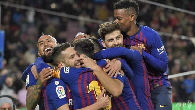 Football: Barcelona hit Sevilla for six to book semi-final place