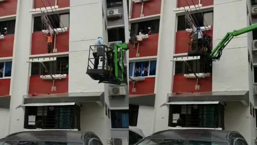 Child standing on window ledge of HDB flat in Hougang rescued by worker