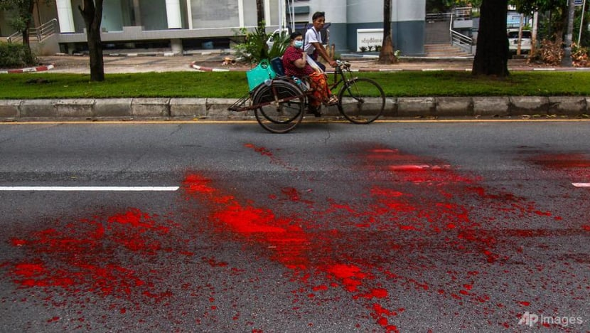 Myanmar protesters paint Yangon red, call for boycott of Water Festival
