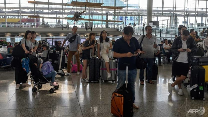 Hong Kong airport reopens but hundreds of flights cancelled, more protests planned