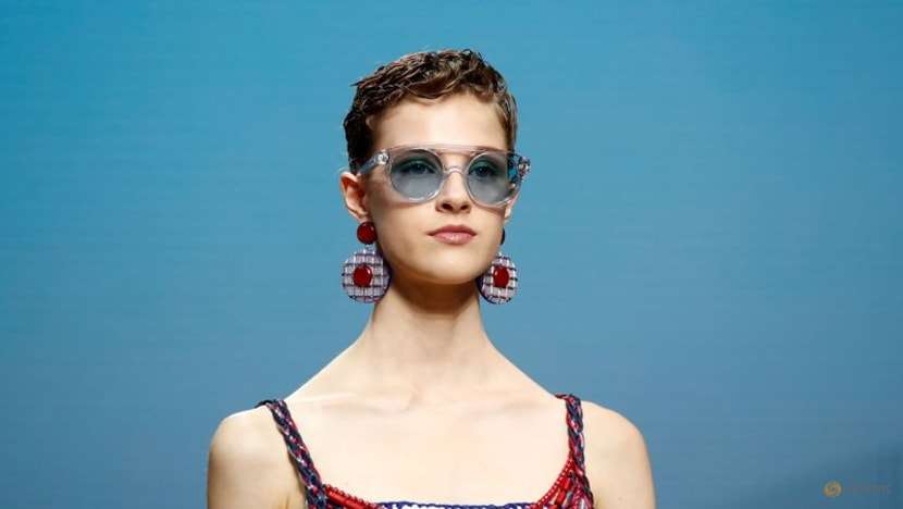 D&G glitter at Milan fashion week, seaside chic for Armani