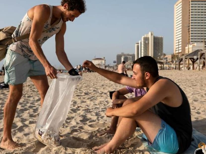For Israeli cigarette butt collector, every day is Earth Day