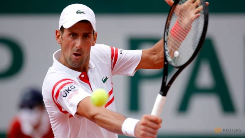 Tennis-Djokovic strolls into third round with clinical victory