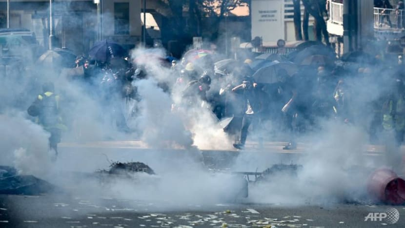 Tear gas fired as Hong Kong protesters defy police, hit the streets on China's National Day