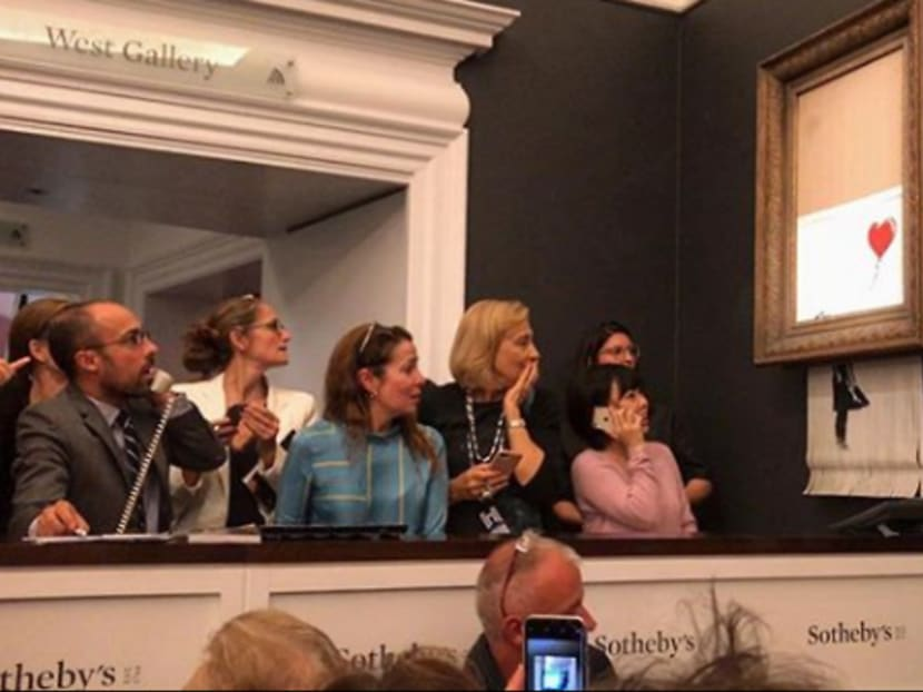 Banksy artwork shreds itself after selling for US$1.4 million at auction