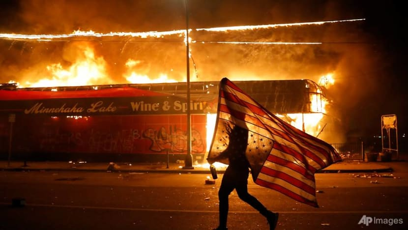 Minneapolis cop charged with third-degree murder in George Floyd case as violent protests sweep US