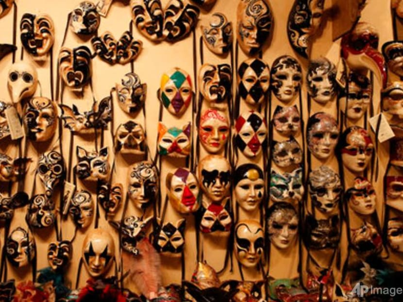 No Carnival festivities in Venice but lots of people in masks