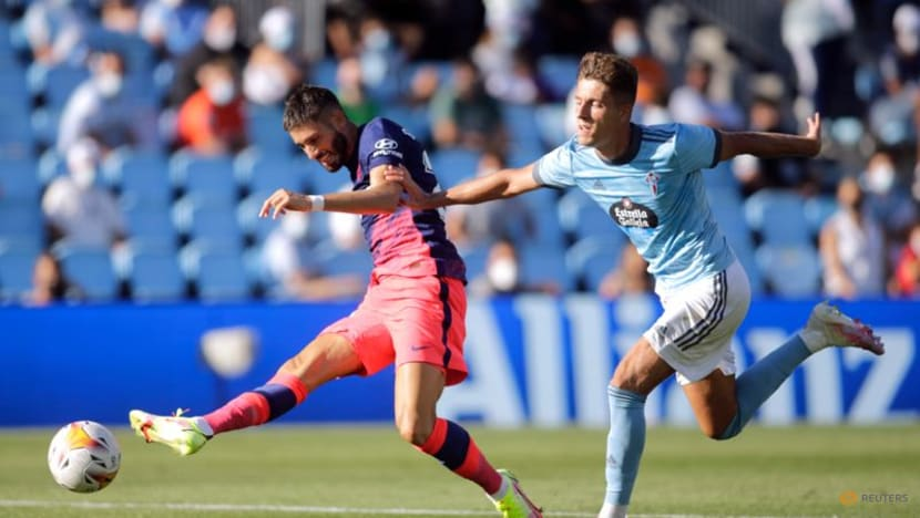 Football: Champions Atletico beat Celta in LaLiga opener as both sides see red
