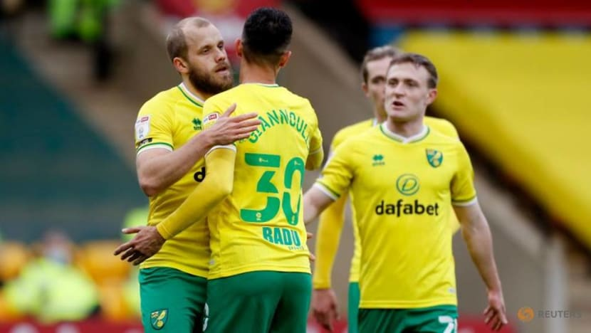 Football: Leaders Norwich ease past Luton, Watford up to second with win